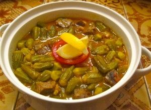 Okra stew...Egyptian Okra Stew....A hearty Okra stew, typically served with lamb or beef, or skip the meat for a vegeterian variation.   My grandma, a busy working woman, didn't spend much time in the kitchen.  Still, she was known to make two dishes really well and Bamya was one of them