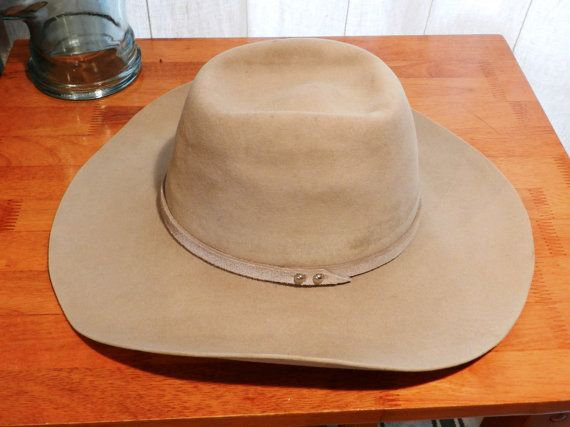 A very nice used Serratelli 6X cowboy hat in a brick crown style with a  wide flat brim. It is a light tan color with matching 1 2 inch wide leather  hatband. 195eee5dd6e5