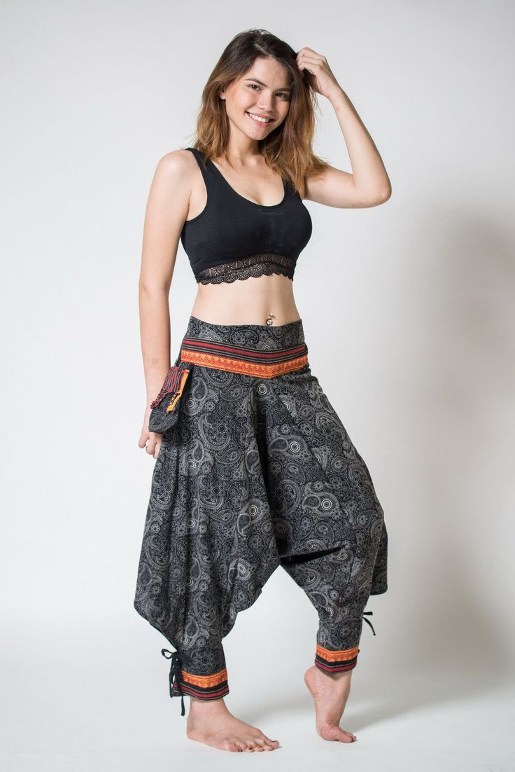 """Amazing Unique Harem Pants made from fairtrade beautiful traditional hill tribe fabric from the North of Thailand. With open-side legs and ankle cuffs with adjustable straps, you can move freely while practicing yoga, doing the split, or chasing butterflies in the mountains of Pai. Suitable for both men and women. Elastic waist on the back allows the pants to fit most sizes. Measurement: Waist: 26""""to 33"""" Hips: up to 42"""" Crotch: 17"""" Inseam: 20"""" Total length: 35"""""""