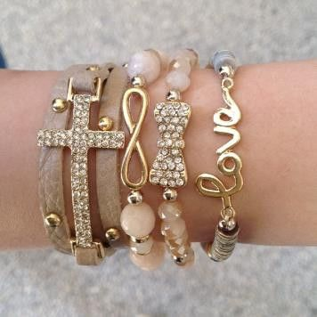 LOVE this stack of bracelets Cute website, great prices. Ibiza | Bracelet | ChichiMe