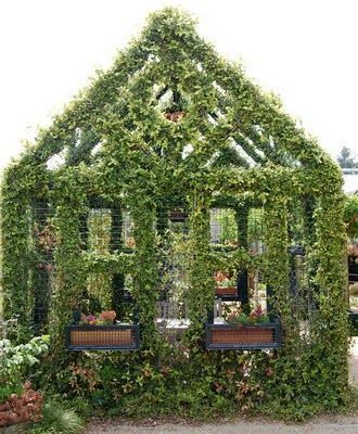 For Earth Day, a little green house that seems to grow right out of the ground. A vine-covered metal framework in the classic shape of every child's first drawing of home, this small structure is in the Children's Garden at The Huntington..