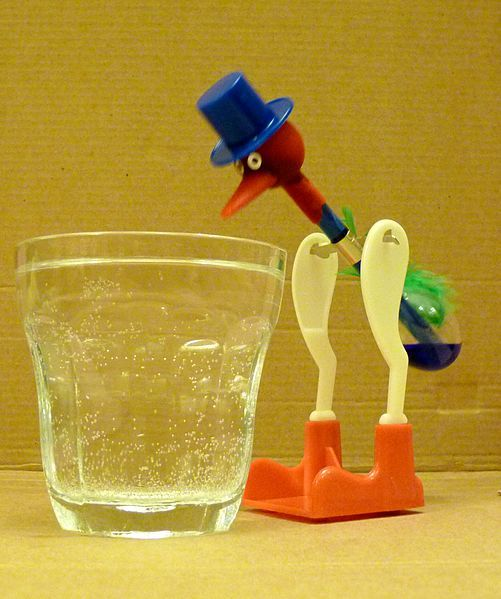 drinking bird.... -- silly things. My mom and dad had one sitting on their TV for years. It rocked back and forth like it was drinking as long as there was water in the glass.