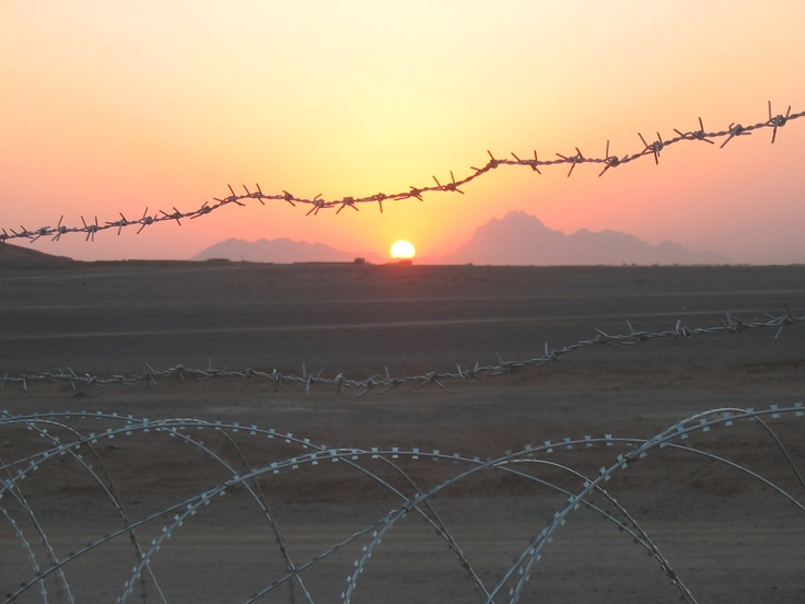 Sunrise through the concertina wire