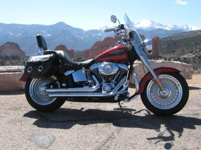 Ruby Red 2008 Davidson Harley Fatboy: The Ruby Red 2008 Harley Fatboy For Sale has $5,000.00 in performance and appearance upgrades, which includes: Vance & Hines exhaust, Detachable Windshield,