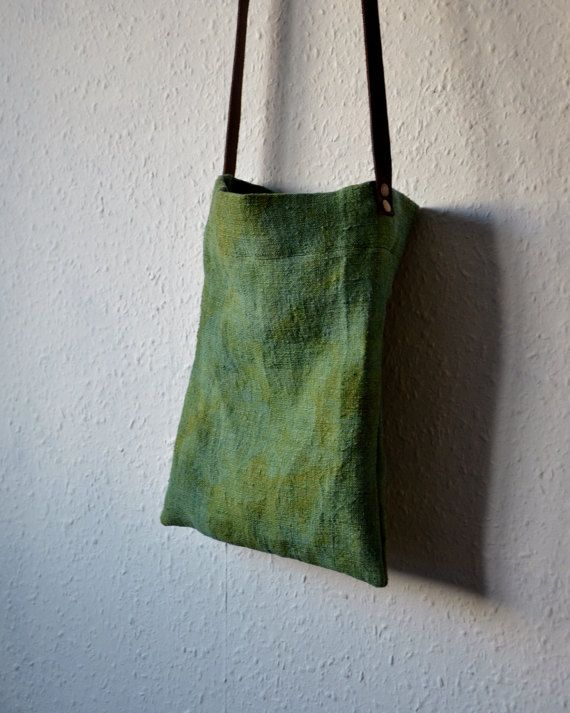 Handmade shoulder handbag/crossbody style day bag made from vintage handwoven linen with a beautiful characterful weave which I have over dyed with herbs and plants to an earthy shade of mottled green. Minimalist and hippie style - taking care of the planet and ourselves.  A simple design to keep your daily needs handy - fits purse, keys, phone, notebook or ipad.  Lined with Japanese turquoise double gauze cotton.  Naturally tanned leather strap - fitted with two antiqued brass studs on...