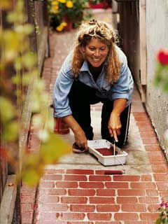 Faux Brick Sidewalk  Claudia Darr mixed a batch of brick-red paint and rolled it right onto a concrete walk. After painting a 100-foot-long path in an afternoon, she was so pleased with the results that she went on to faux brick her entire driveway.