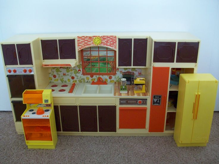 Sears Kitchen Center Play Set by Wolverine, 1970's - The set came in two color schemes, orange and brown and green and white. It included at large set of accessories, all very well made, as is the kitchen itself. It is slightly larger scale than Mattel Barbie items and makes her look like a height challenged person. The photo includes the 1978 Mattel fridge and stove for size comparison.