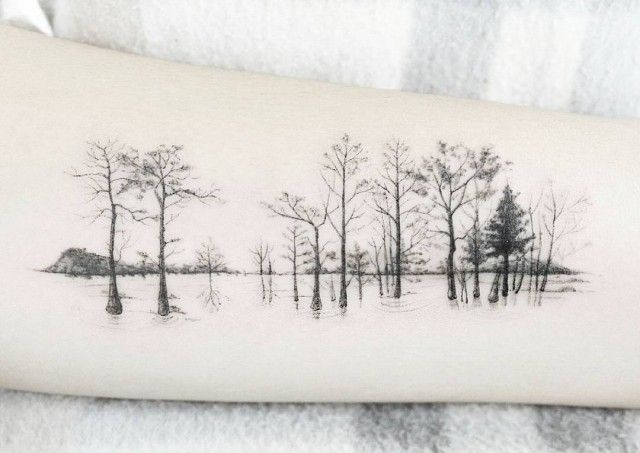 arm tattoo of trees with one color