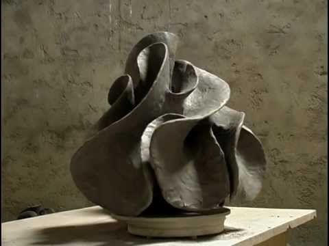 The camera observes closely how Alexandra Engelfriet molds pieces of clay into an object of art. The video is shot in her studio in France. 10 min. No audio. ++++.