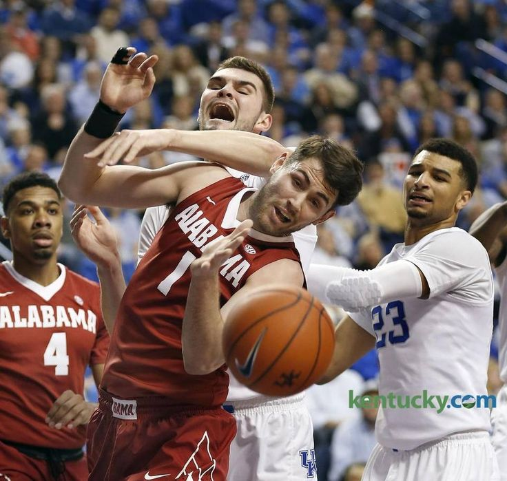 Kentucky Wildcats forward Isaac Humphries (15) battled Alabama Crimson Tide forward Riley Norris (1) for a rebound as the University of Kentucky played the University of Alabama in Rupp Arena in Lexington, Ky., Tuesday, February 23 2016. This is first half mens basketball action.