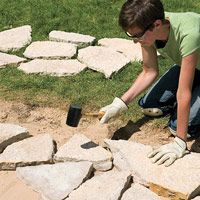 DIY Flag Stone Patio....maybe for I between garden beds