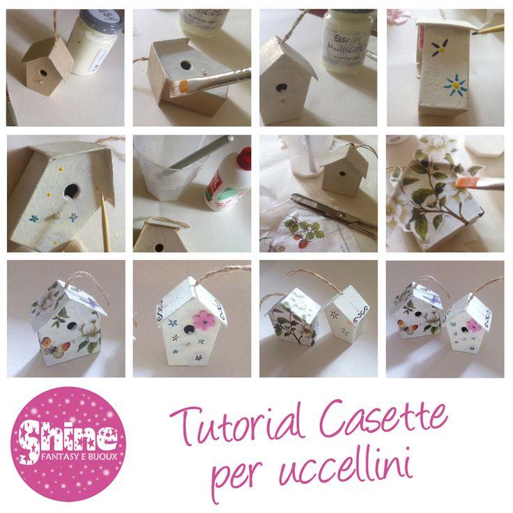 Una casetta per uccellini in cartone pressato, decorate con acrilico bianco, smalto per unghie e fiore in feltro. L'altra pitturata prima con acrilico bianco e poi in decoupage con carta di riso. Poi verniciate.