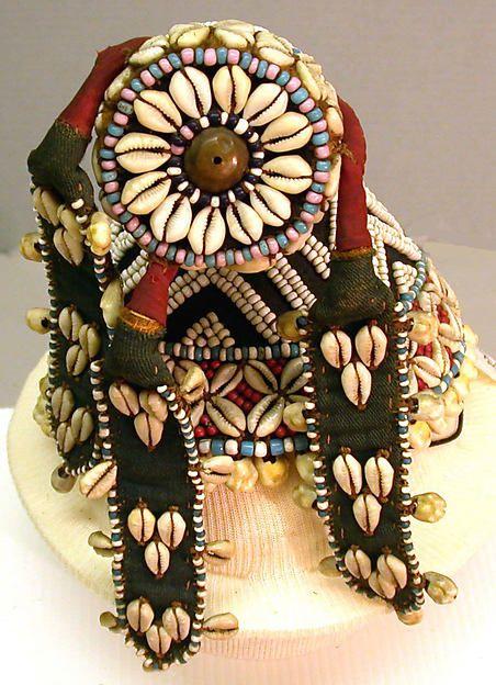 Hat (Kalyeem)  Date:19th–20th centuryGeography:Democratic Republic of the Congo, Central AfricaCulture:KubaMedium:Raffia, glass beads, cowrie shells, cotton cloth