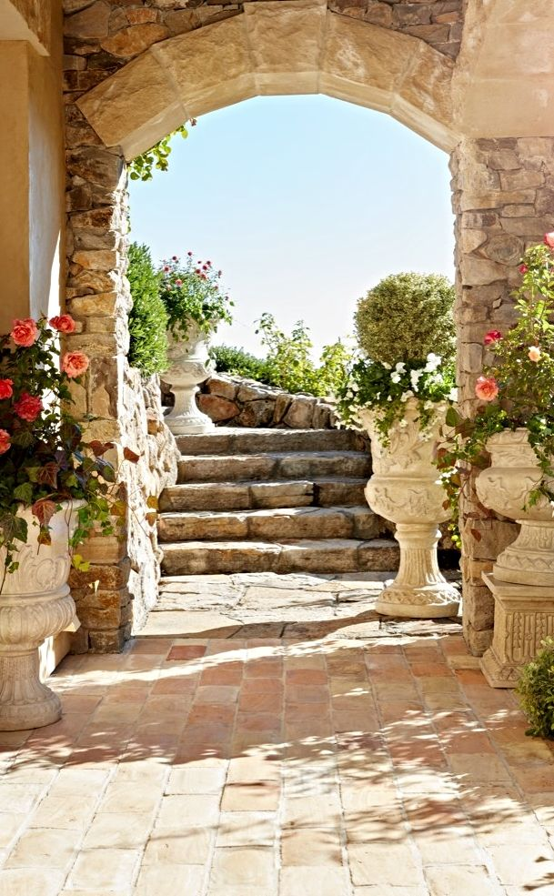 Chateau inspired. To the manor born. Enchanting European-influenced urns....    Frontgate Inspired Living