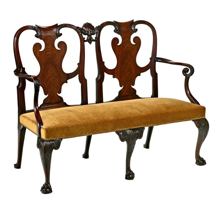 "An Irish George II Mahogany Two Chairback Settee, Circa 1740 - With serpentine crest rails terminating in eagle heads and joined by a finely carved shell, over highly figured splats; the molded armrests having conforming eagle head terminals, the over-upholstered seat raised on front cabriole legs having acanthus carved knees and ball and claw feet. LENGTH: 53"" DEPTH: 21"" HEIGHT: 40"" - Hyde Park Antiques, Ltd., New York"