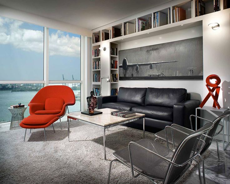 modern interior design of new york city apartment with red womb chair and black leather sofa and stainles steel wire chairs decor ideas exquisite gorgeous