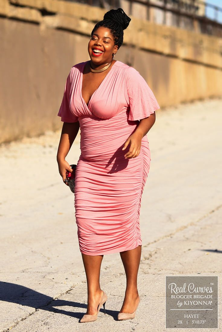 """You'll be full of happiness and laughter when you wear our plus size Rumor Ruched Dress, just like blogger Hayet (5'10.75"""" and a size 2x). Find more style inspiration and made in the USA fashions at www.kiyonna.com. #kiyonnaplusyou"""