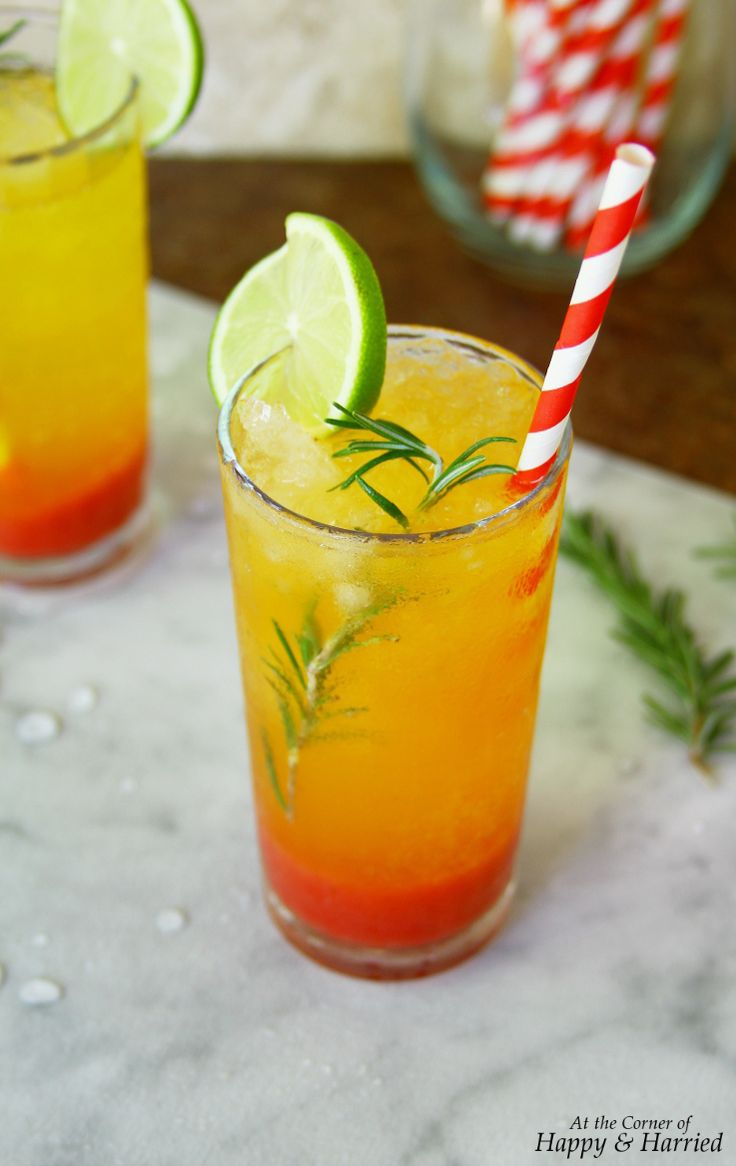 SUNRISE MOCKTAIL. Enjoy a tall drink of the prettiest drink ever, a sunrise mocktail made with strawberry syrup, sparkling clementine juice and rosemary. Bring it on, summer! #happyandharried #sunrise #sunshine #mocktail #cocktail #drink #beverage #cold #strawberry #clementine #orange #rosemary #lime #soda