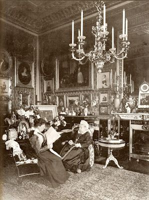 Queen Victoria's Private Sitting Room.  Queen Victoria knits while Princess Beatrice reads to her. Photographed by Mary Steen in 1895. - Windsor Castle