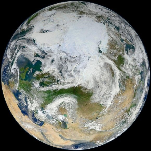 This latest portrait of Earth from NASA's Suomi NPP satellite puts the icy Arctic in the center, showing the ice and clouds that cover our planet's northern pole. The image you see here was created from data acquired during fifteen orbits of Earth.