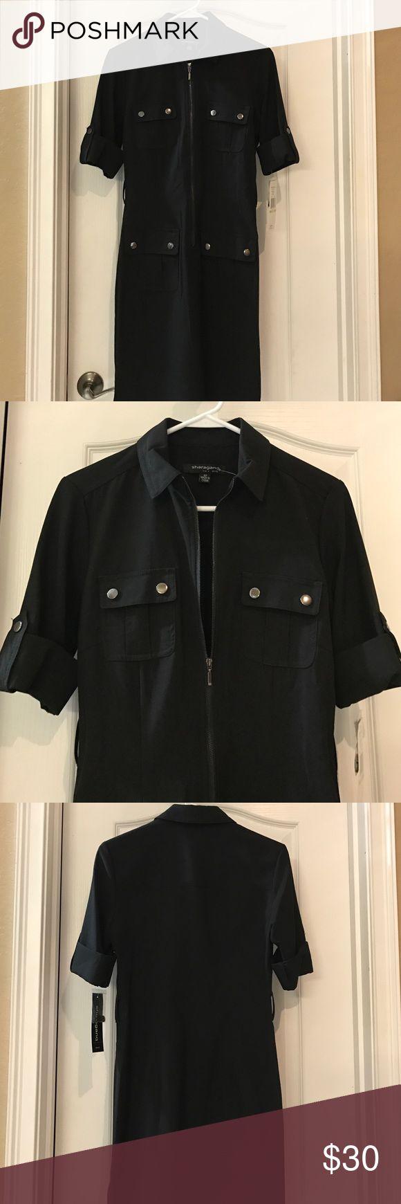 New black zip up dress 👗 w/ 4 functional pockets. New Black zip up dress 👗 with four functional pockets. Stretch sharagano Dresses Midi