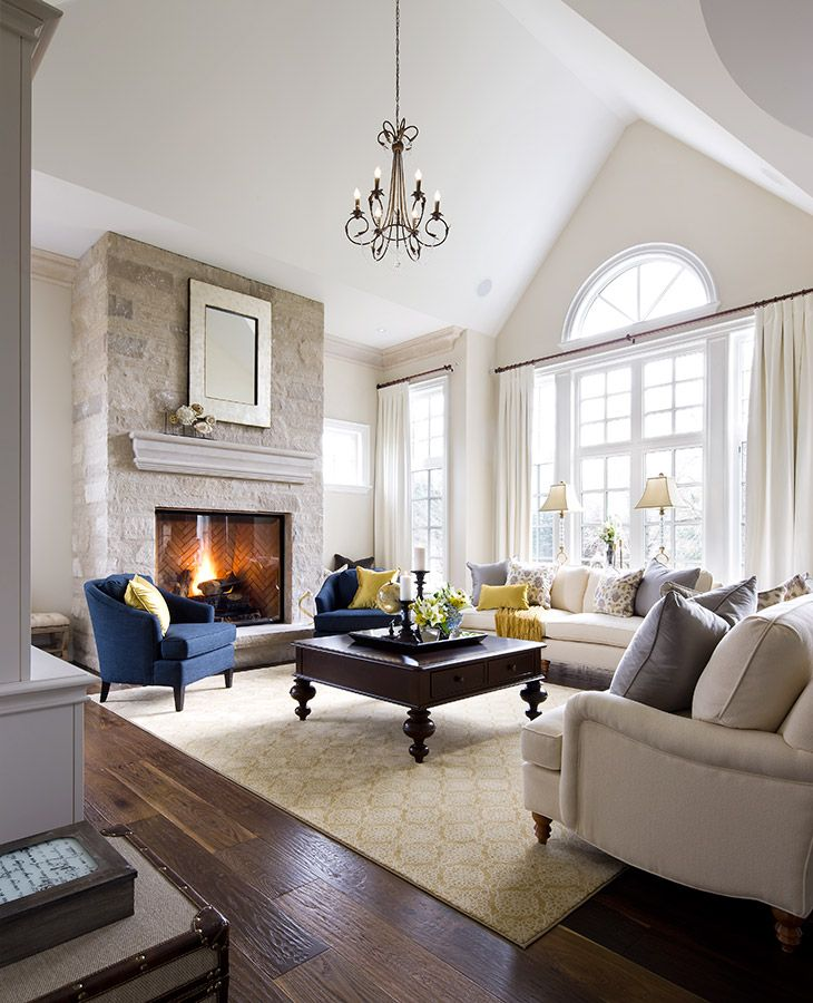 benjamin moore ballet white in a formal living room with stone fireplace and accent chairs by jane lockhart design