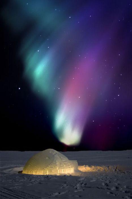 Aurora Borealis (Northern Lights) over an igloo.