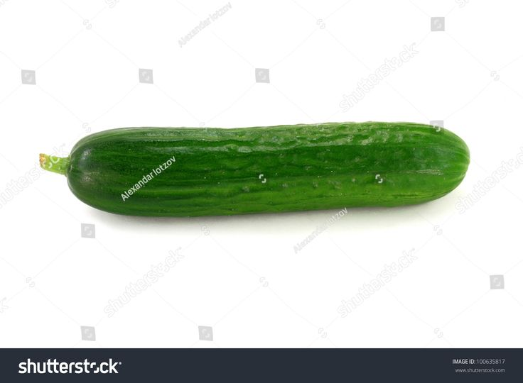 Stock Photo of One Baby Cucumber over white Background.
