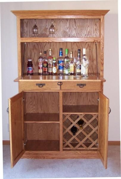 No bar or liquor collection would be complete without a custom bar cabinet  or liquor cabinet. Contact expert craftsmen