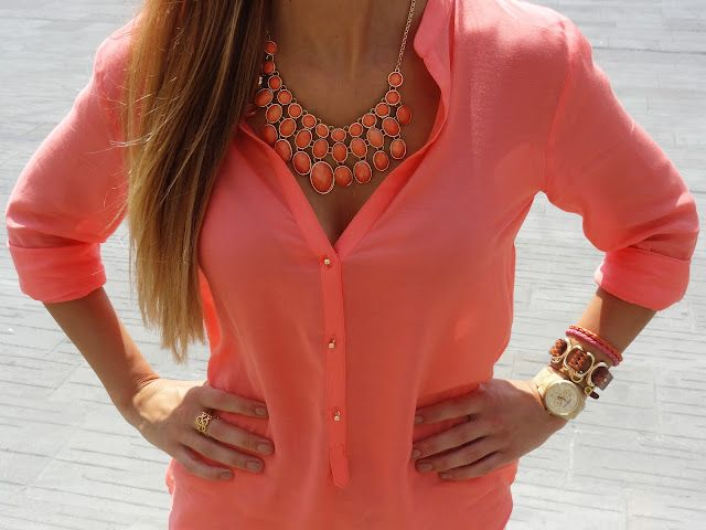 Pink shirt for woman with statement necklace. Combination is elegant but girly.