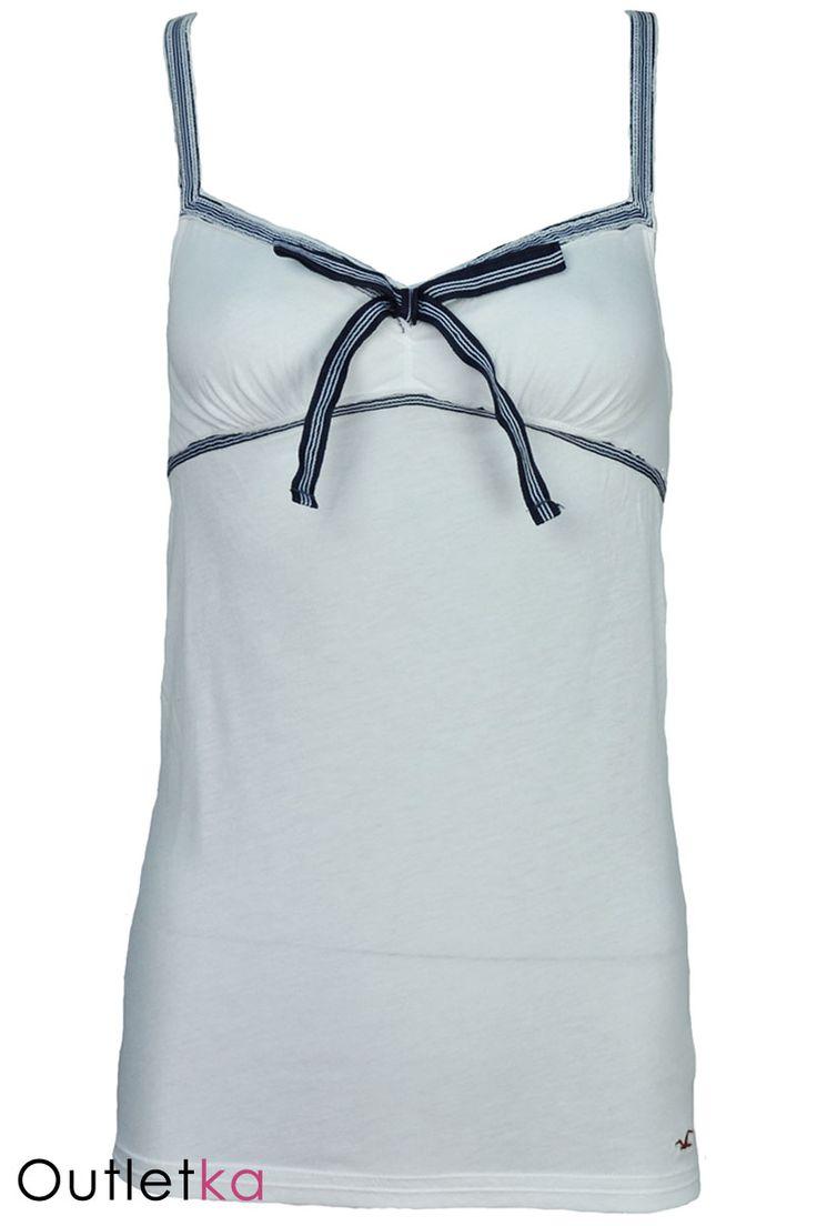 Nowa bluzka firmy Hollister (marka firmy Abercrombie). Bluzka w odcieniach koloru białego. Dekolt ozdobiony piękną kokardką. Materiał bardzo dobry gatunkowo. Na dole charakterystyczne logo firmy.