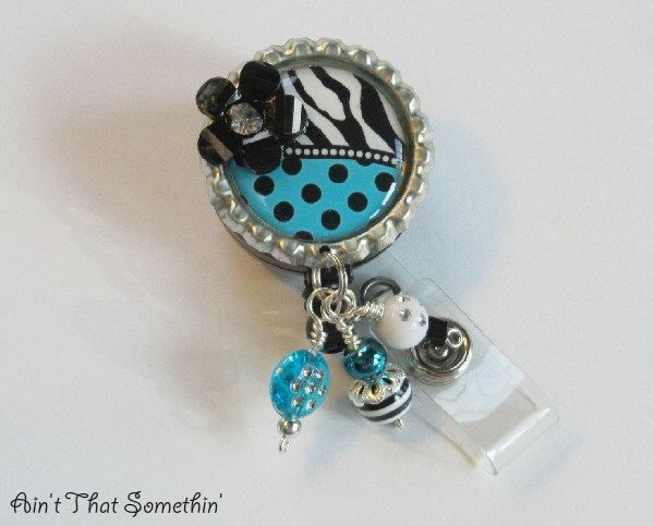 Turquoise Dots N' Zebras Retractable Badge Reel - Fun Badge Clip - Unique ID Holder - Designer Badge Pull - Cute Badge Reel - Diva ID Holder by AintThatSomethin on Etsy https://www.etsy.com/listing/105419952/turquoise-dots-n-zebras-retractable