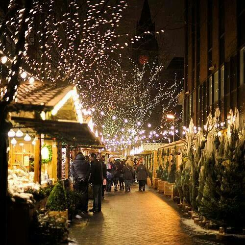 Manchester Christmas Market, the annual collection of traditional German-style food and craft market stalls in City Centre, 2010, Manchester, UK, photograph by Claire Basiuk.