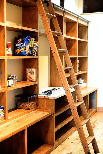 Now THAT'S a pantry.  I like the idea of the ladder, but frankly I think I would fall off of it and bust my butt.