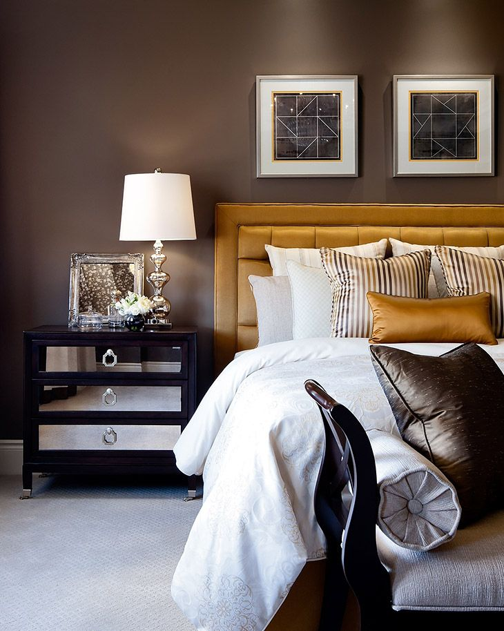 Jane Lockhart bedroom with gold accents and earth tones