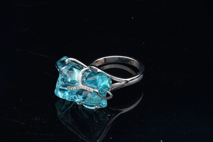 Organic Shape Aquamarine & Diamond ring by Hubert.