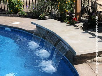 concrete bench over pool water feature