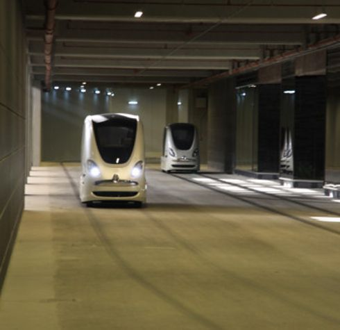 "In order to reduce its carbon footprint, Masdar City uses a driverless ""personal rapid transport"" system..."