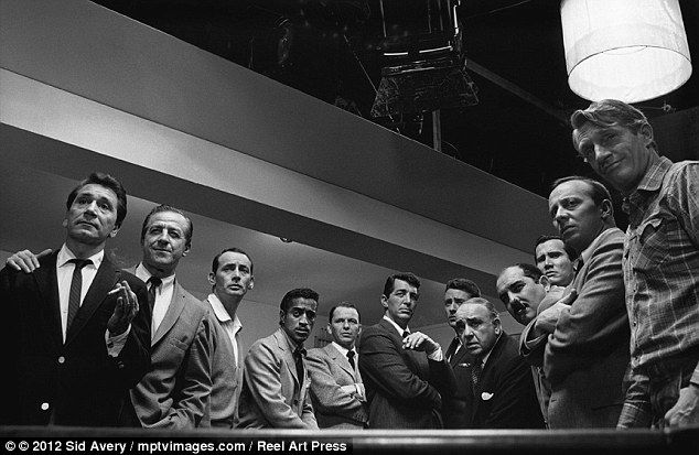 Cool and the gang: The cast of the original Ocean's Eleven movie on set in 1960 with (from fourth left) Sammy Davis Jr, Frank Sinatra and Dean Martin (Photographed by Sid Avery)