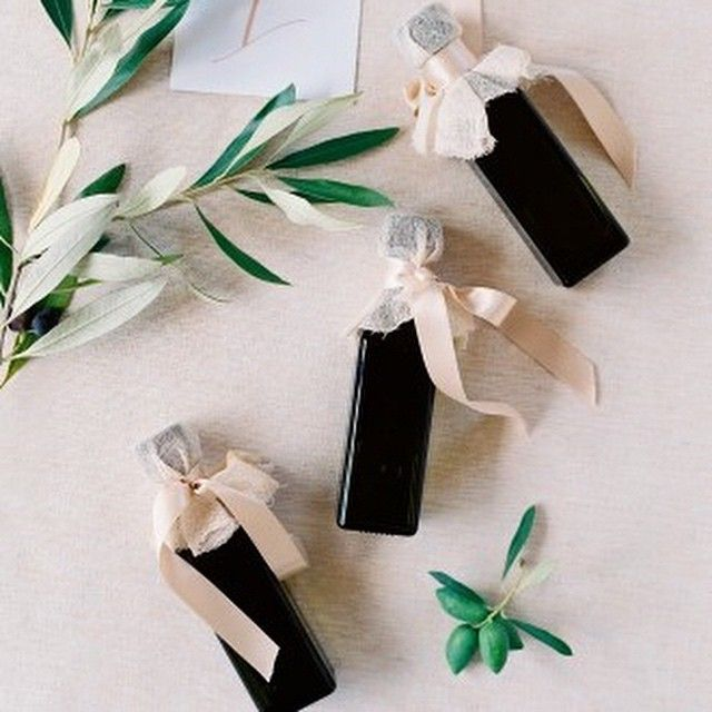 Clever wedding favor idea! Each guest received a small bottle of olive oil that was cold-pressed by the bride's parents using olives grown at the ceremony site. To see more photos from this real wedding click the link in our bio! | : @josevilla #marthaweddings #weddinginspo via @angela4design