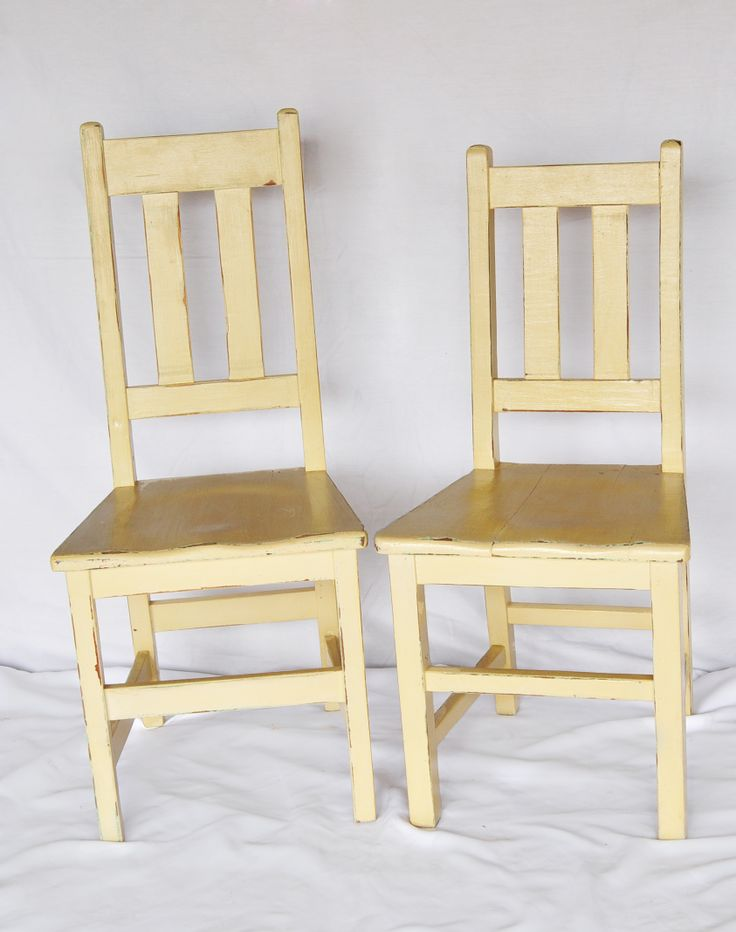 Old school chairs in white enamel: These old school chairs typically have two slats in the back, a solid seat, came in two height variants (pictured) and were made from imported teak. #AntiqueShops #Johannesburg #SouthAfrica #Furniture #Chairs #Teak #SchoolChairs