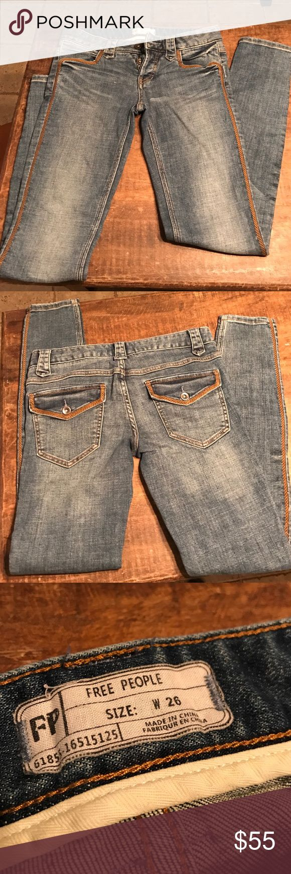 Free People jeans. Sz 26 Cute FP skinny jeans sz 26. Button Fly with brown piping down each leg and on front and back pockets. Inseam 30. Free People Jeans Skinny