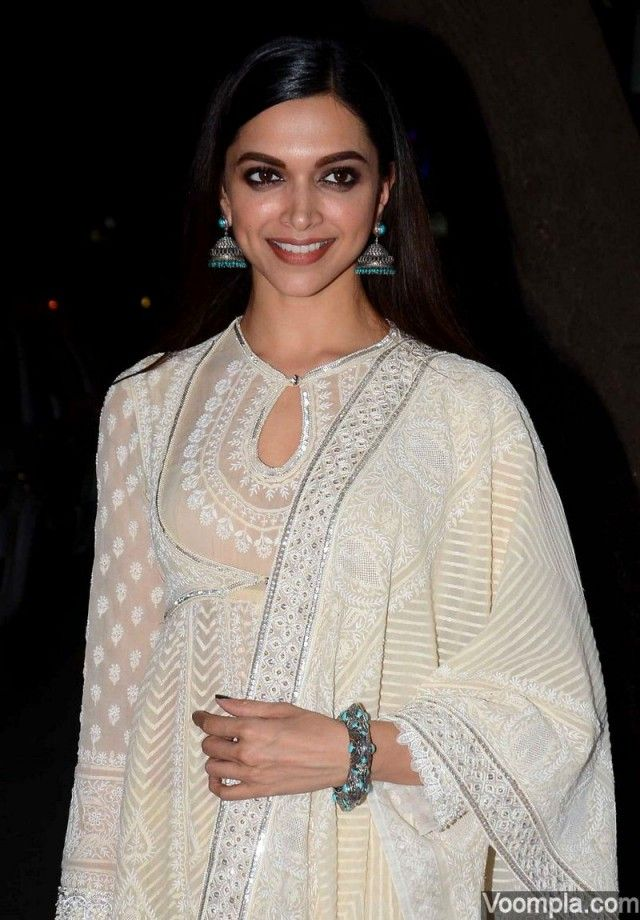 Deepika Padukone goes traditional in a gorgeous white Abu Jani Sandeep Khosla chikankari anarkali paired with turquoise earrings and bangles by Amrapali - styled by Shaleena Nathani, hairstyle by Gabriel Georgiou and makeup by Puneet B Saini. via Voompla.com