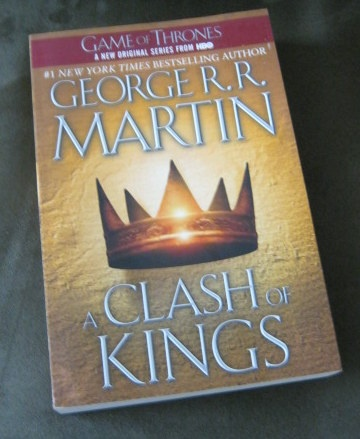 Book: A Clash of Kings - Book 2 Game of Thrones...    (Season 2 of Game of Thrones starts tonight !  It is expected to cover the story of A Clash of Kings)  This book is way better than the first in terms of scope, plot lines and characterization.  Political and military alliances proved to be secondary to individual ambitions to sit on the Iron Throne. Fast-paced, loaded with action and great dialogues, this is truly darker, bloodier but heartwarming as well.     Author: George R.R. Martin