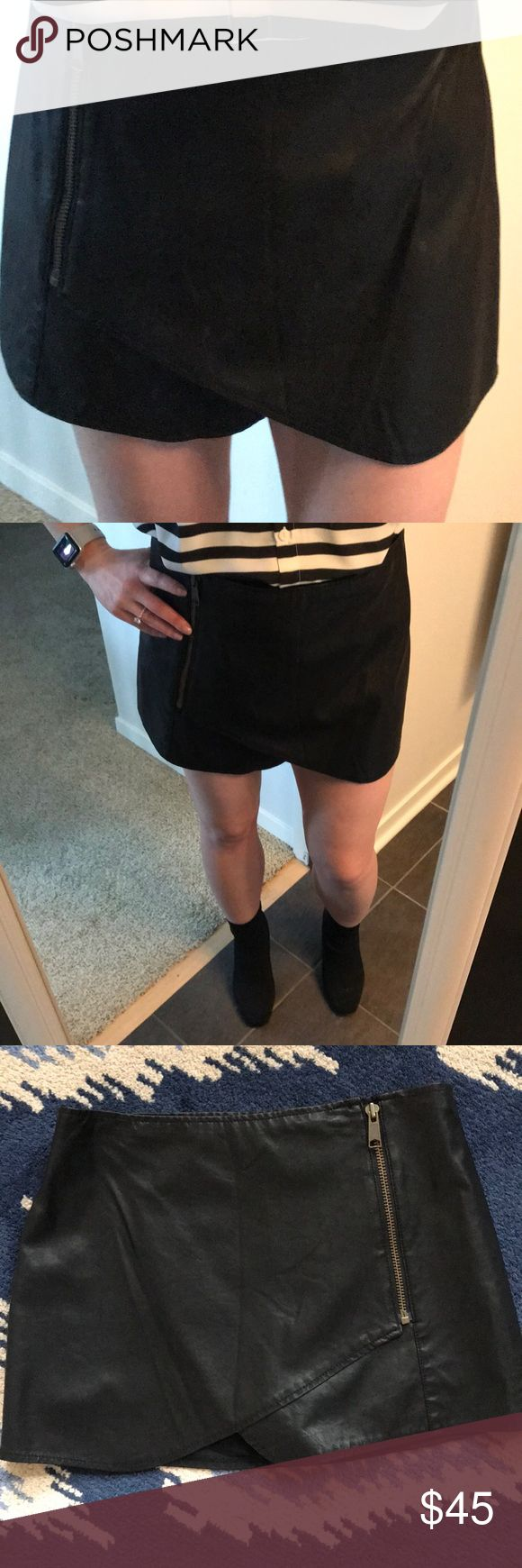 Free People leather mini skirt Built-in stretchy shorts for secured fit and feel. Front has cross over design with zipper on left hip. This skirt looks really cute with sock booties (as pictured) or OTK boots. Machine wash cold. Do not dry clean. Free People Skirts Mini