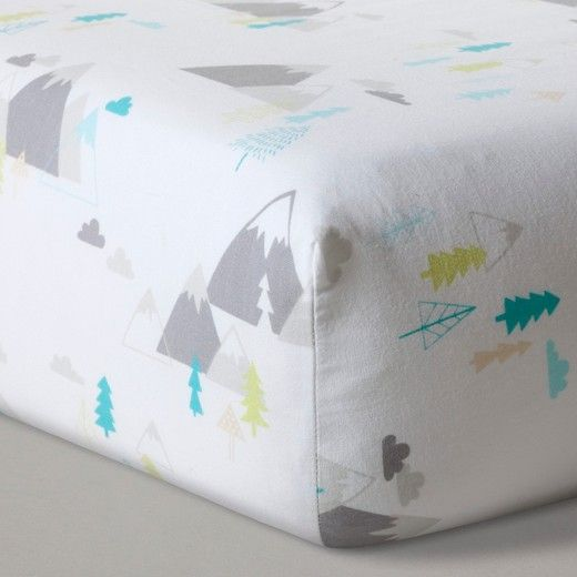 """Dreamland calls to your little one with this White Mountain Print Fitted Crib Sheet from Cloud Island™. A mountain and tree print decorating the soft 100 percent cotton sheet sets the perfect stage for dreams full of adventure. The full elastic ensures your sheet will fit perfectly, wash after wash. <br><br>Sleep Safely, Little One<br>When putting baby to sleep, """"Bare is Best"""" in the crib. Use a firm, tight-fitting mattress and remove pillows, qu..."""