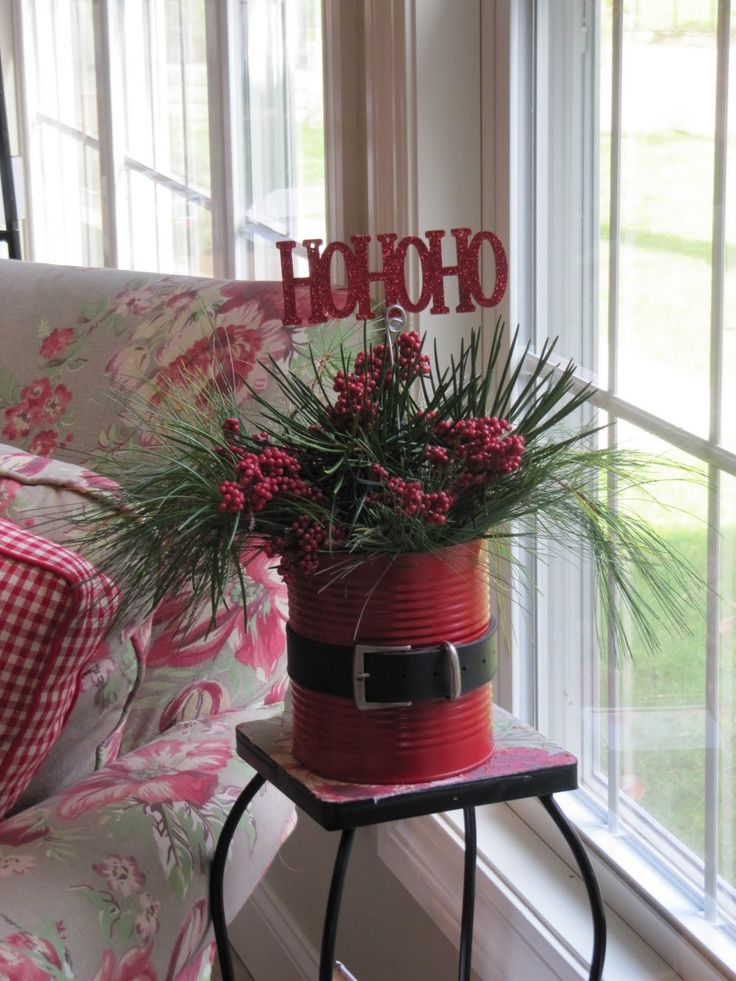 Christmas (coffee can sprayed red, an old belt from a thrift store) fresh pine & berries. Looks very festive & simple to do. . . . . .