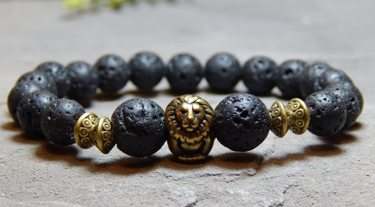 About the Bracelet The spirit of the Lion with the strength of Lava create this earthy mens bracelet. Bracelet Details: This mens bracelet is made with: - 10mm and 8mm Volcano Rock - Brass TierraCast