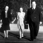 Alma Reville and Alfred Hitchcock promenade with daughter Patricia.  A very young Hitchcock.