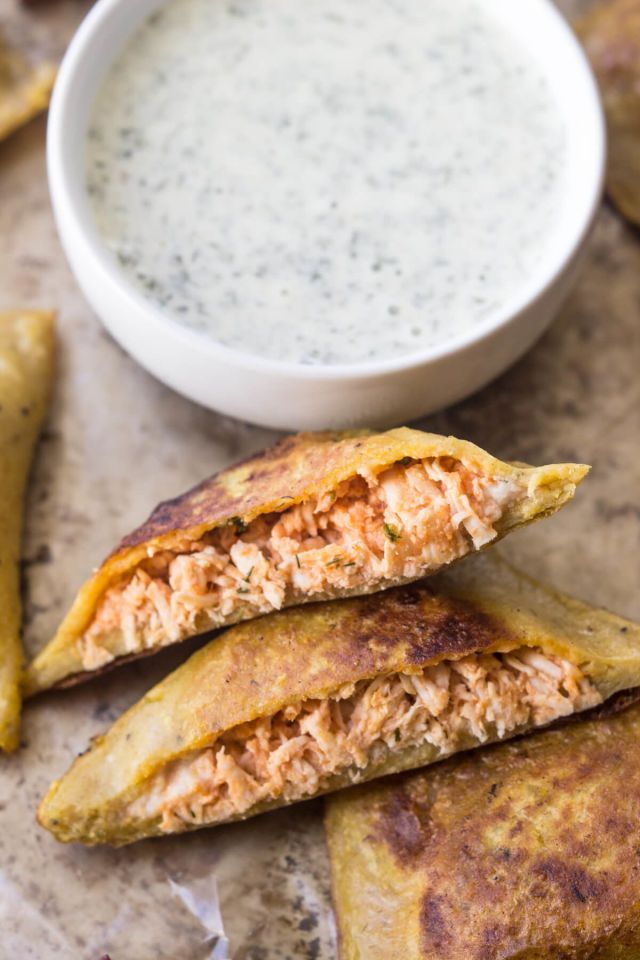 25 Paleo Snacks-Easy Paleo Recipes-BUFFALO CHICKEN PIZZA POPPERS A game-day classic reinvented just for the modern cave(wo)man. Head over to redbookmag.com to learn how to make this healthy game-day favorite.